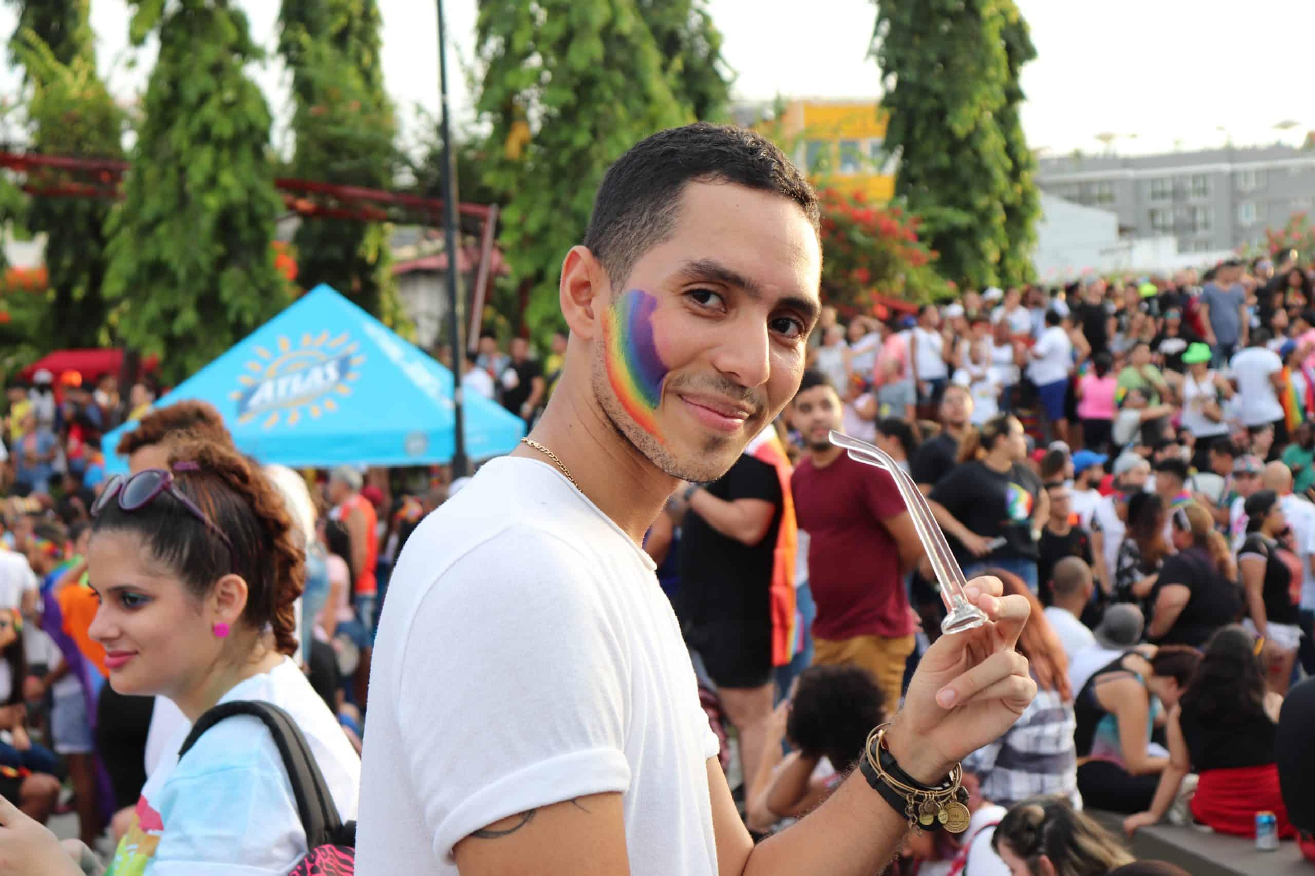 Man smiling at Pride event