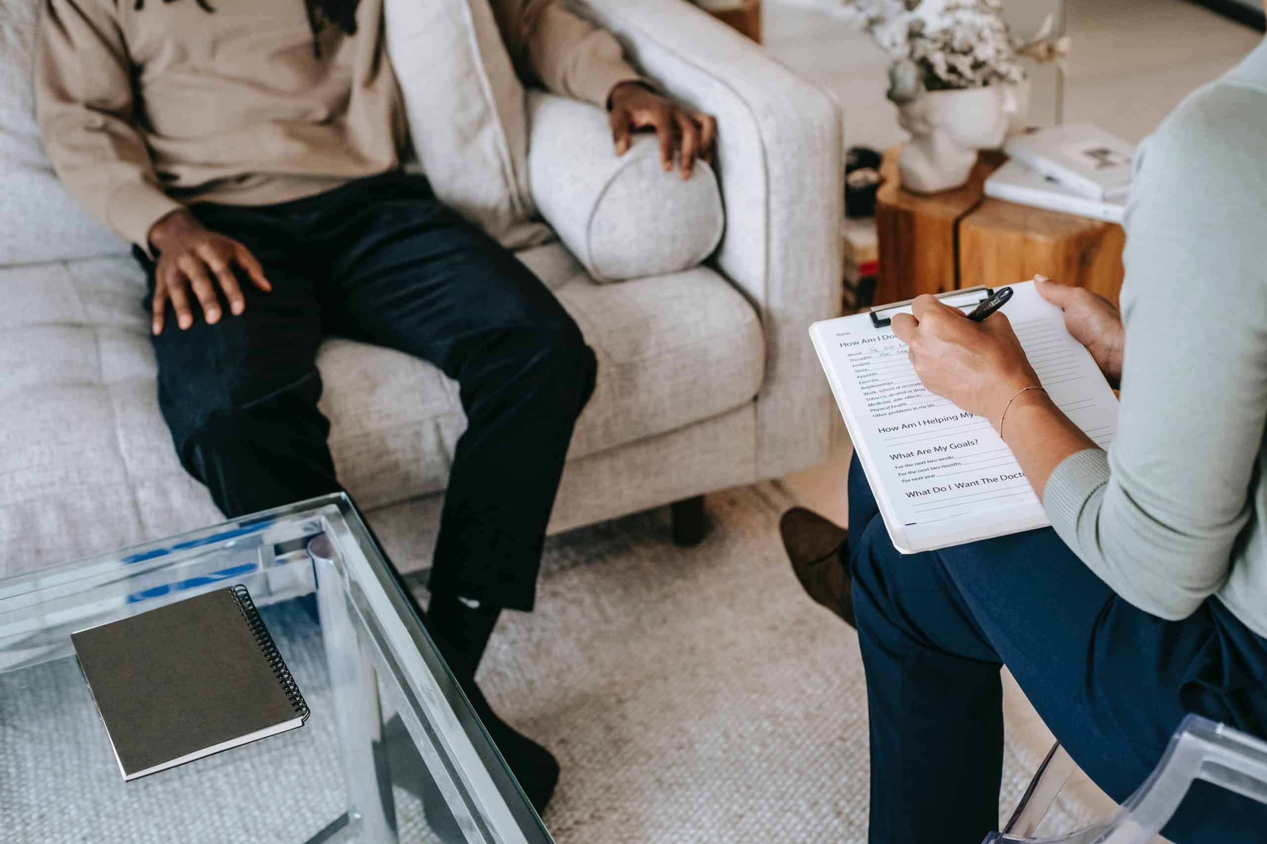 Therapist and client sitting in appointment