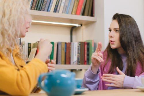 Two women speaking in ASL